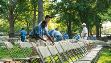 Setting up chairs for commencement