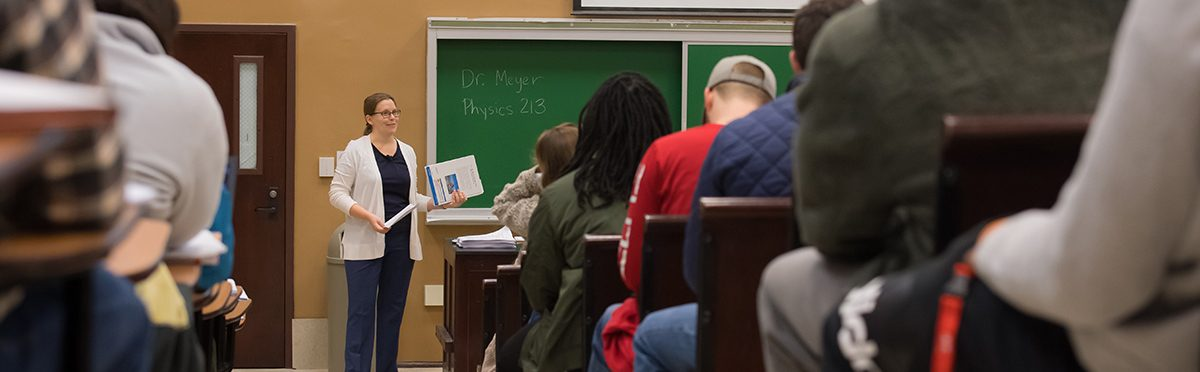 Professor teaching physics class